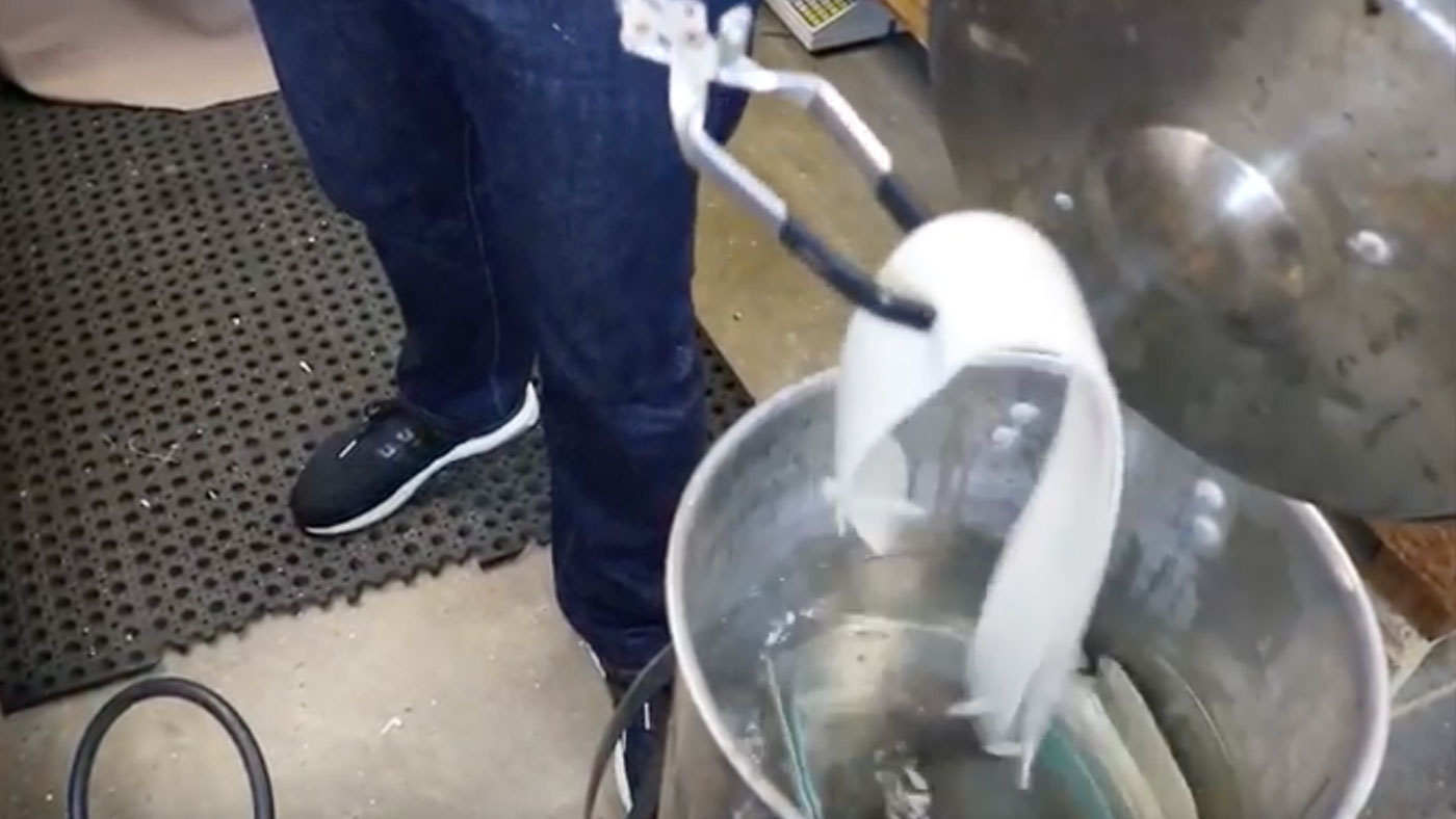 boiling the slings in a pan