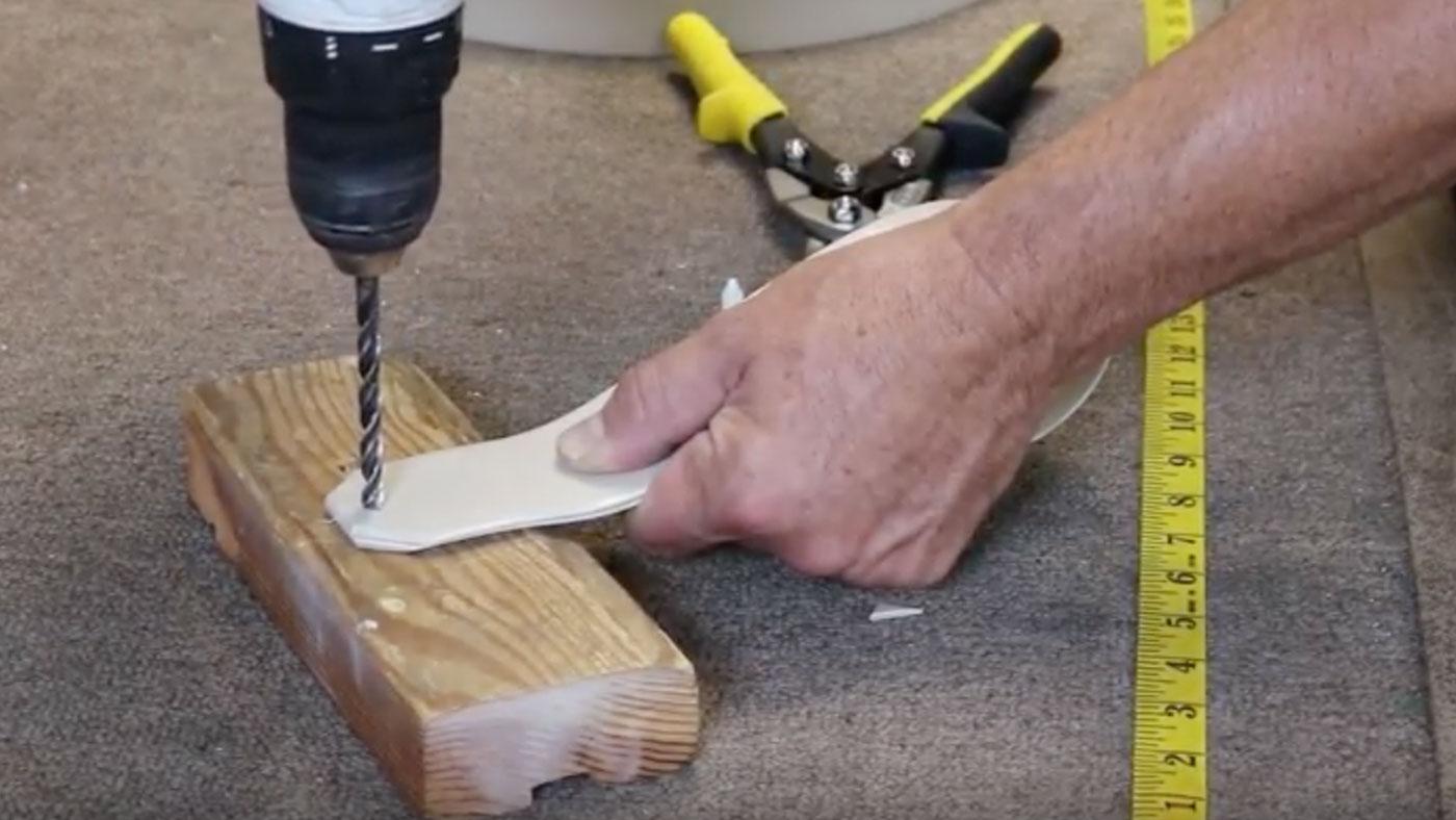 drill holes in vinyl strap