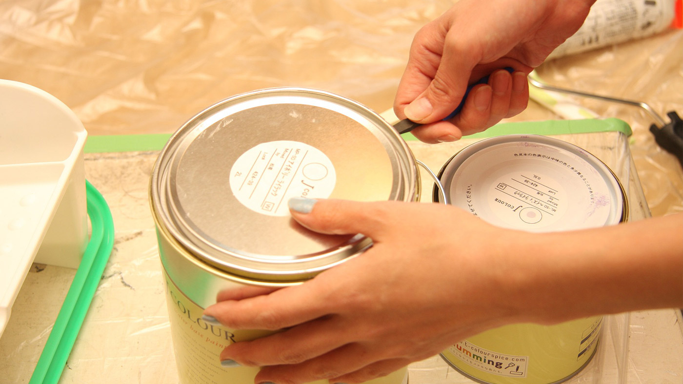 woman opening paint can